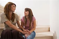 Mother and daughter having a chat Stock Photo - Premium Royalty-Freenull, Code: 614-00967989