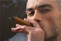 Man Smoking Cigar    Stock Photo - Premium Royalty-Freenull, Code: 600-00983018