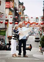 Couple Looking at Map in Street, Chinatown, Kearny Street, California, USA    Stock Photo - Premium Rights-Managednull, Code: 700-00983388