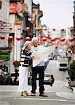Couple Looking at Map in Street, Chinatown, Kearny Street, California, USA    Stock Photo - Premium Rights-Managed, Artist: Mark Leibowitz, Code: 700-00983388