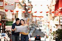 Couple Looking at Map in Street, Kearny Street, Chinatown, San Francisco, California, USA    Stock Photo - Premium Rights-Managednull, Code: 700-00983400
