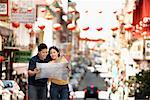 Couple Looking at Map in Street, Kearny Street, Chinatown, San Francisco, California, USA    Stock Photo - Premium Rights-Managed, Artist: Mark Leibowitz, Code: 700-00983400