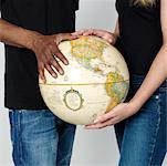 Hands Resting on Globe