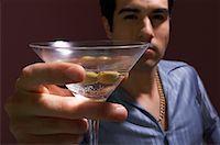Man Drinking Martini    Stock Photo - Premium Royalty-Freenull, Code: 600-00983874