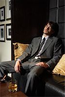 Man Asleep on Sofa with Cigar and Liquor    Stock Photo - Premium Royalty-Freenull, Code: 600-00984352