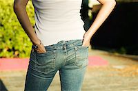 Woman's Rear End in Jeans Stock Photo - Premium Royalty-Freenull, Code: 621-00994694
