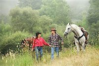 Couple with horses/ Stock Photo - Premium Royalty-Freenull, Code: 604-01001239