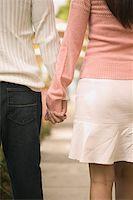 Couple Holding Hands Stock Photo - Premium Royalty-Freenull, Code: 621-01011216