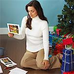 Woman Sitting on Floor Writing Christmas Cards Stock Photo - Premium Royalty-Free, Artist: Klick, Code: 621-01012456