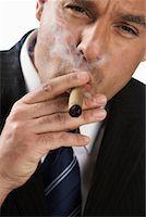 Businessman Smoking Cigar    Stock Photo - Premium Rights-Managednull, Code: 700-01015006