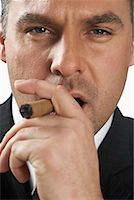 Businessman Smoking Cigar    Stock Photo - Premium Rights-Managednull, Code: 700-01015007