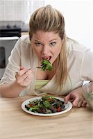 Woman Eating Salad    Stock Photo - Premium Rights-Managednull, Code: 700-01015031