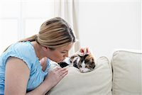 Woman on Sofa with Kitten    Stock Photo - Premium Rights-Managednull, Code: 700-01015040