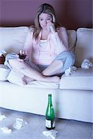 Woman with Red Wine Crying on Sofa    Stock Photo - Premium Rights-Managednull, Code: 700-01015064