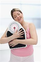 Woman Hugging Scale    Stock Photo - Premium Rights-Managednull, Code: 700-01015080