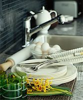 Dishes Stacked Beside Kitchen Sink    Stock Photo - Premium Royalty-Freenull, Code: 600-01015276