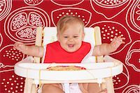 Baby with Spaghetti in High Chair    Stock Photo - Premium Royalty-Freenull, Code: 600-01015390