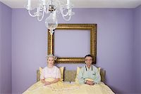 Couple in bed looking miserable Stock Photo - Premium Royalty-Freenull, Code: 614-01028139