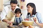 Family Baking Cookies    Stock Photo - Premium Rights-Managed, Artist: Jerzyworks, Code: 700-01029668