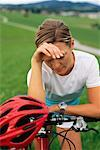 Cyclist Taking a Break, Looking at Watch    Stock Photo - Premium Rights-Managed, Artist: Bryan Reinhart, Code: 700-01030323