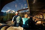 Passengers looking out Window on Rocky Mountaineer Train, Mount Robson, Alberta, Canada