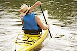 Rear view of a mid adult man kayaking Stock Photo - Premium Royalty-Freenull, Code: 625-01039207