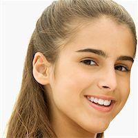 preteen girl - Portrait of a girl smiling Stock Photo - Premium Royalty-Freenull, Code: 625-01039744