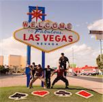 Five teenage boys posing in front of a Las Vegas sign board, Las Vegas, Nevada, USA