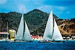Two sailboats are seen participating in the Heiniken Regatta on the Dutch side of the island of St. Maarten in the