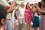 Couple Dancing at Family Gathering    Stock Photo - Premium Rights-Managed, Artist: Tim Mantoani, Code: 700-01041252
