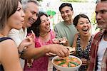 People Eating at Family Gathering    Stock Photo - Premium Rights-Managed, Artist: Tim Mantoani, Code: 700-01041257