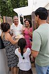 Family being Greeted at Family Gathering    Stock Photo - Premium Rights-Managed, Artist: Tim Mantoani, Code: 700-01041259