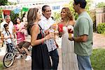 People Drinking at Family Gathering    Stock Photo - Premium Rights-Managed, Artist: Tim Mantoani, Code: 700-01041276