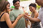 People Drinking at Family Gathering    Stock Photo - Premium Rights-Managed, Artist: Tim Mantoani, Code: 700-01041279