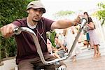 Man on Bicycle at Family Gathering    Stock Photo - Premium Rights-Managed, Artist: Tim Mantoani, Code: 700-01041306