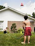 Boys Playing in Sprinkler    Stock Photo - Premium Rights-Managed, Artist: Dan Lim, Code: 700-01041382
