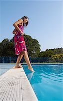 Woman at Side of Swimming Pool    Stock Photo - Premium Royalty-Freenull, Code: 600-01041644
