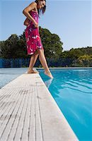 Woman at Side of Swimming Pool    Stock Photo - Premium Royalty-Freenull, Code: 600-01041645