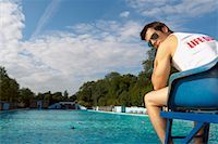 Lifeguard Watching Swimming Pool    Stock Photo - Premium Royalty-Freenull, Code: 600-01041705