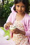 Girl Holding Cupcake    Stock Photo - Premium Royalty-Free, Artist: Masterfile, Code: 600-01041943