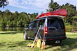 SUV With Canoe Parked By Lake    Stock Photo - Premium Rights-Managed, Artist: Graham French, Code: 700-01042113