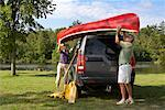 Couple Unloading Canoe From SUV    Stock Photo - Premium Rights-Managed, Artist: Graham French, Code: 700-01042114
