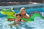 Grandmother and Granddaughter in Swimming Pool    Stock Photo - Premium Rights-Managed, Artist: Graham French, Code: 700-01042148