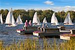 Two Couple on Docks, Watching Sailboat Race, Bobcaygeon, Ontario, Canada    Stock Photo - Premium Rights-Managed, Artist: Graham French, Code: 700-01042150
