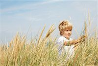 Portrait of Boy Standing in Tall Grass    Stock Photo - Premium Rights-Managednull, Code: 700-01042826
