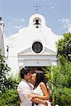 Couple Kissing Outside Church