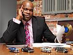 Businessman Doing Paperwork    Stock Photo - Premium Royalty-Free, Artist: Masterfile, Code: 600-01043239