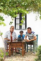 Grandfather, Father and Son Watching Television in Backyard    Stock Photo - Premium Royalty-Freenull, Code: 600-01043369