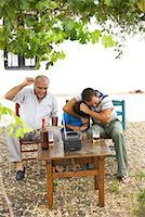 Grandfather, Father and Son Watching Television in Backyard    Stock Photo - Premium Royalty-Freenull, Code: 600-01043374