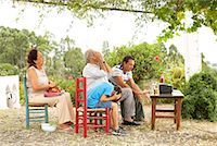 Grandfather, Grandmother, Father and Son Watching Television in Backyard    Stock Photo - Premium Royalty-Freenull, Code: 600-01043378